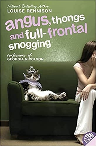 Book cover shows protagonist Georgia and pet cat sitting on a green couch; title text in bold font on top of cover