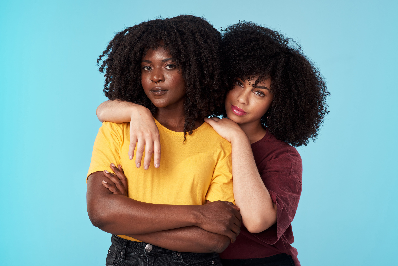 Two Black women embracing