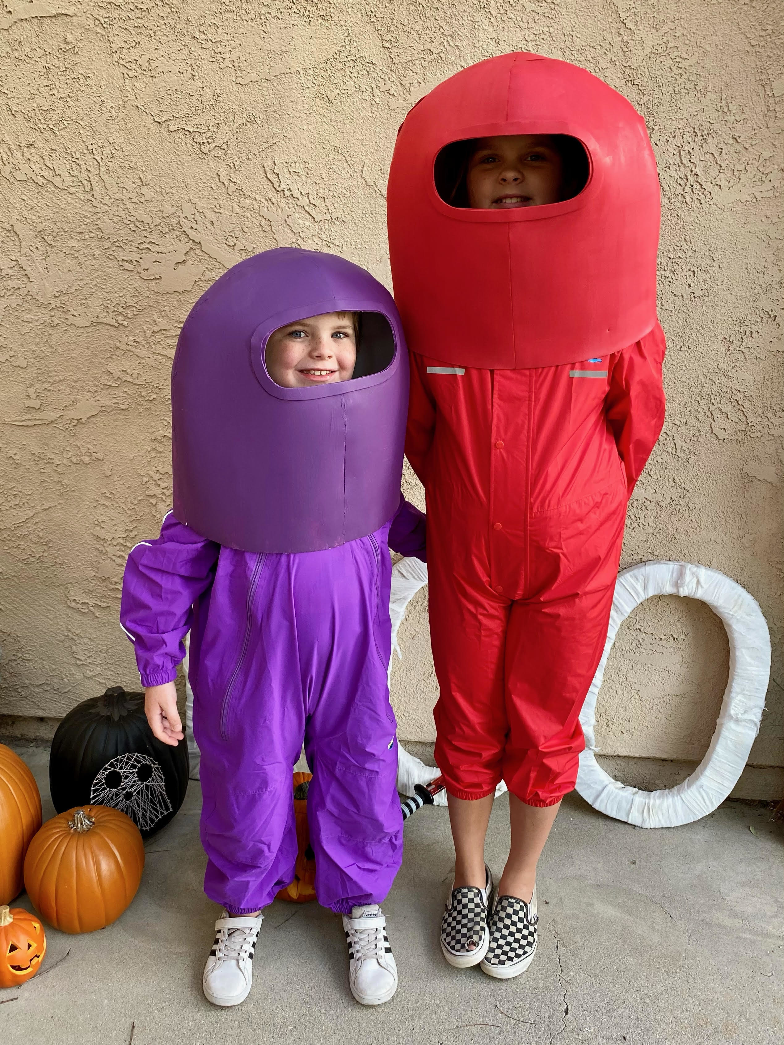 """Two kids in DIYed """"Among Us"""" costumes"""