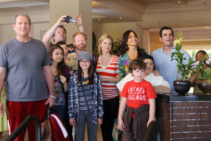 The cast gathered together in a scene from an early episode