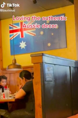 a wooden australian flag on a wall