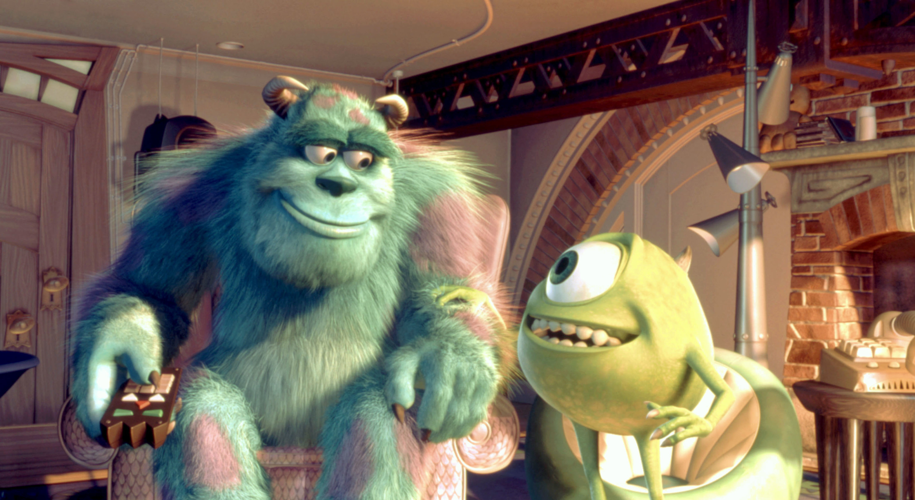 Sulley and Mike Wazowski smiling at each other while watching TV