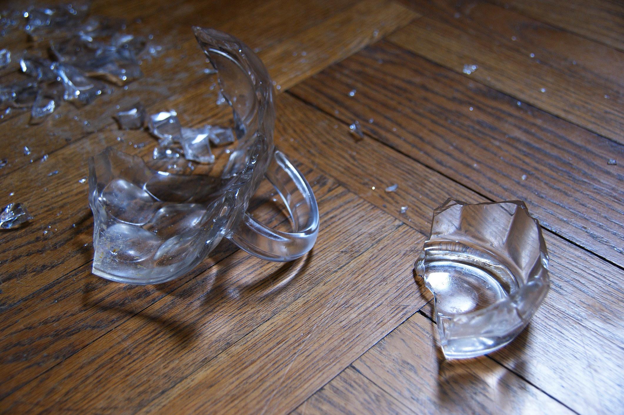 Broken glass cup on floor