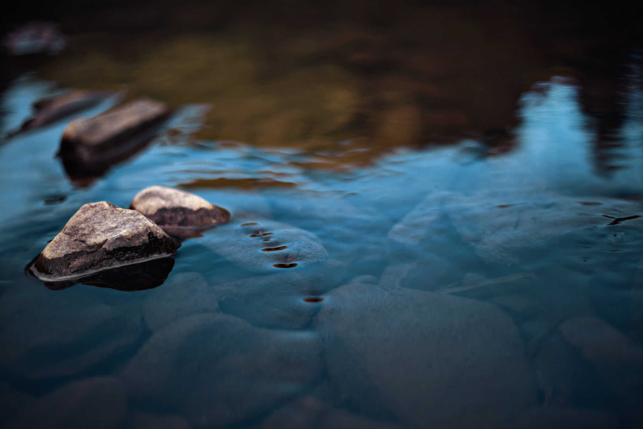 Rocks in stream with smooth flowing water