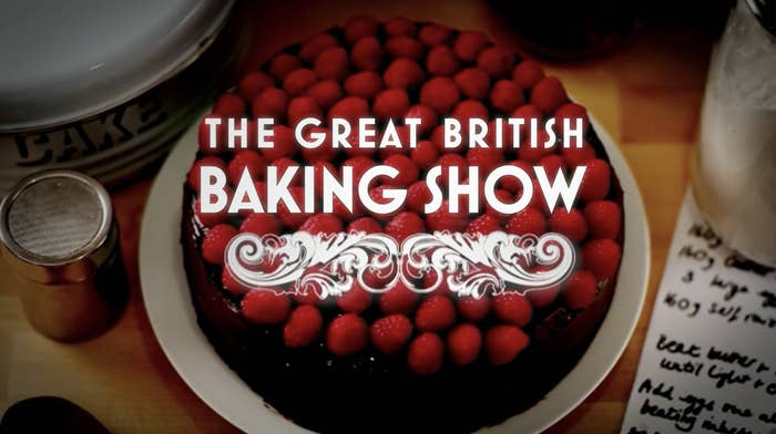 the title card for The Great British Baking Show which features a cake topped with raspberries
