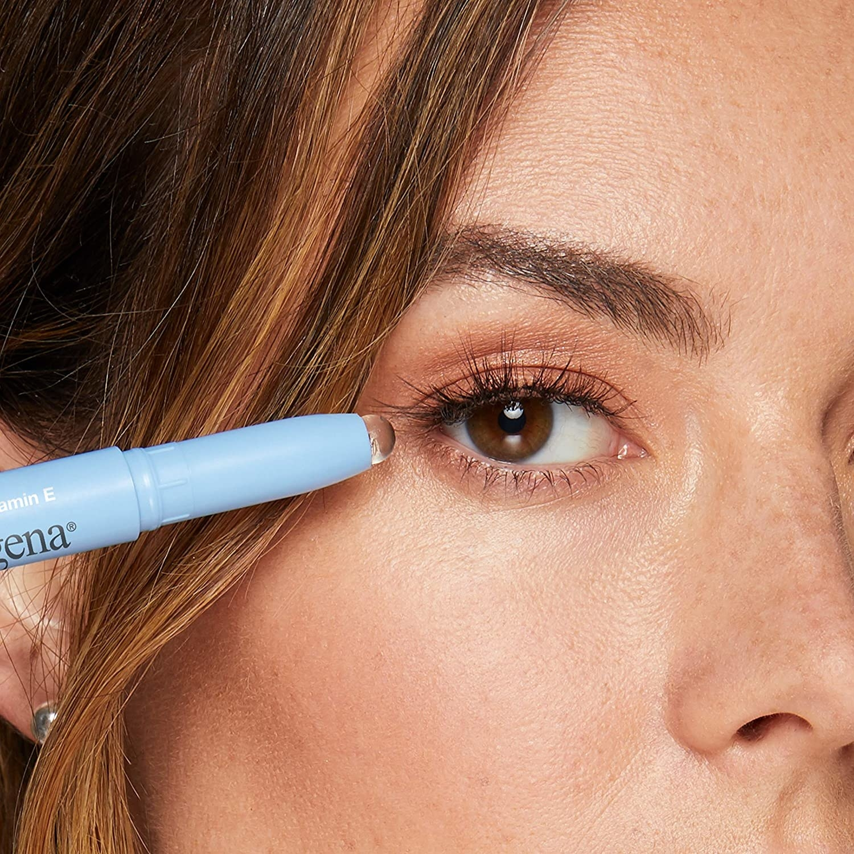 Model using the stick to correct eyeliner