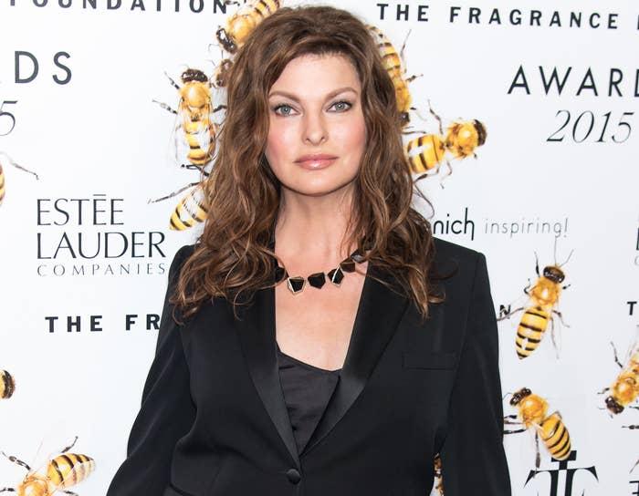 Linda poses in a black blazer before the procedure