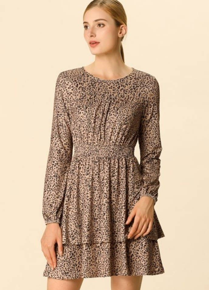 A model wearing a leopard printed, long sleeve, ruffled hem dress