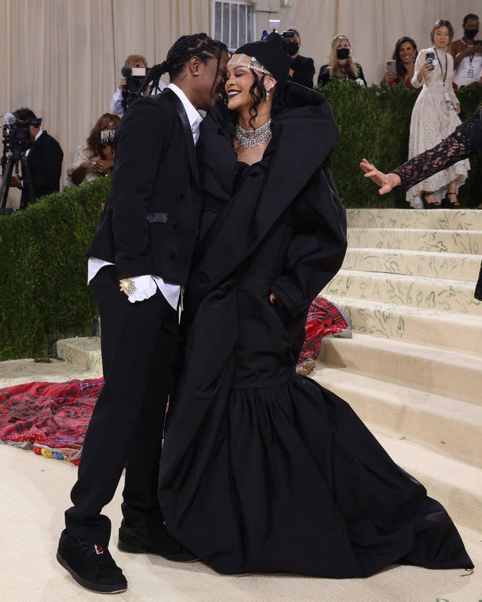 Rihanna and ASAP Rocky smiling on the steps at the 2021 Met Gala