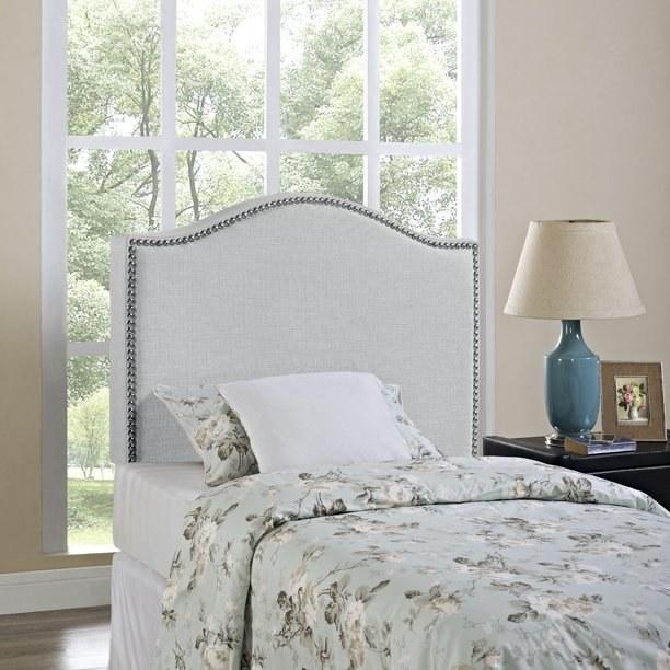 grey headboard with floral bedspread