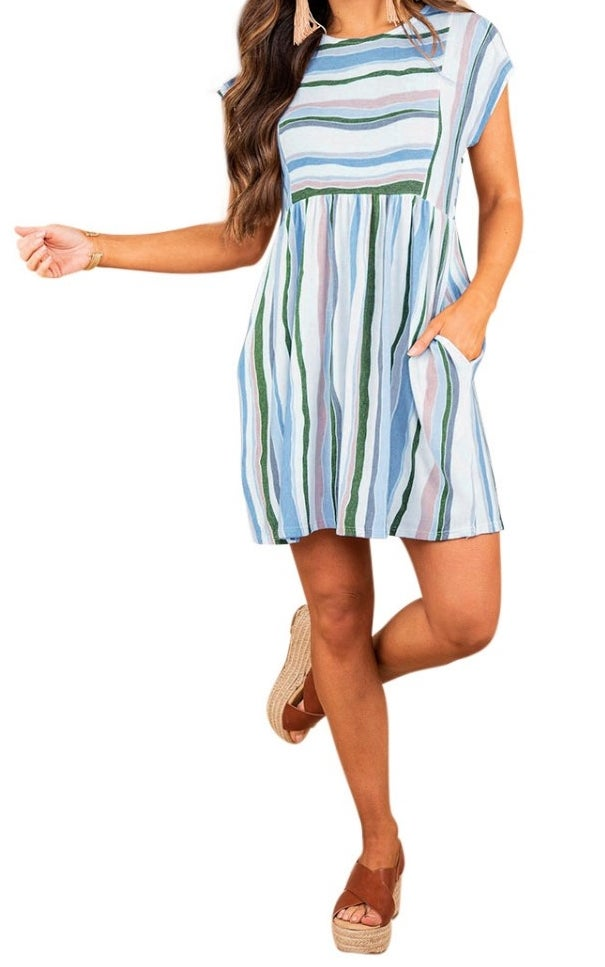 A model wearing a blue/white/green/pink striped round neck mini dress with pockets