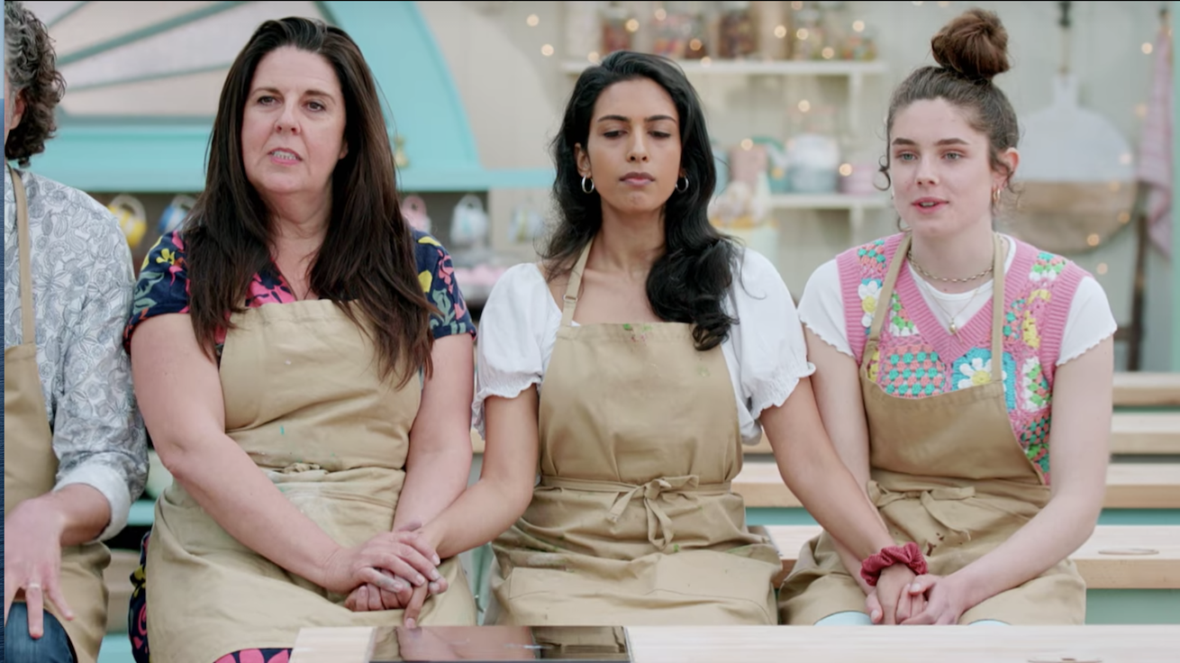 Three bakers hold each other's hands
