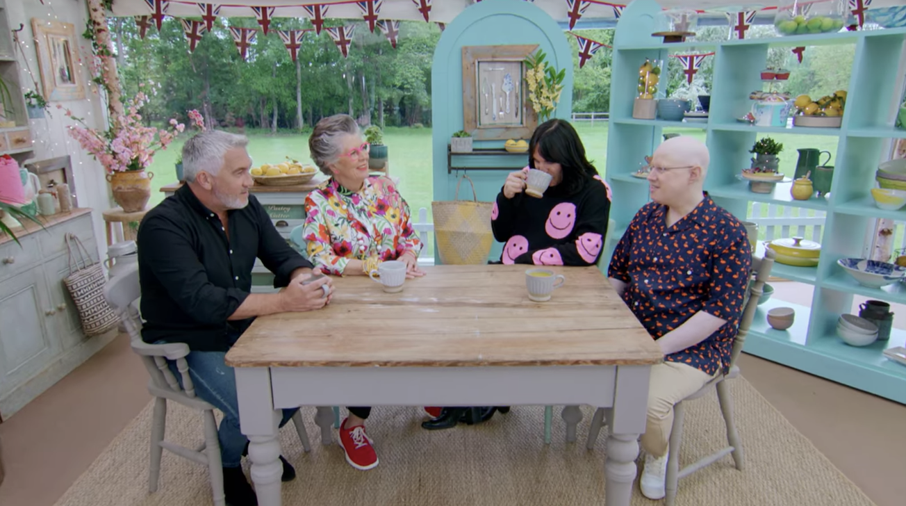 The judges and hosts enjoying a cup of tea together