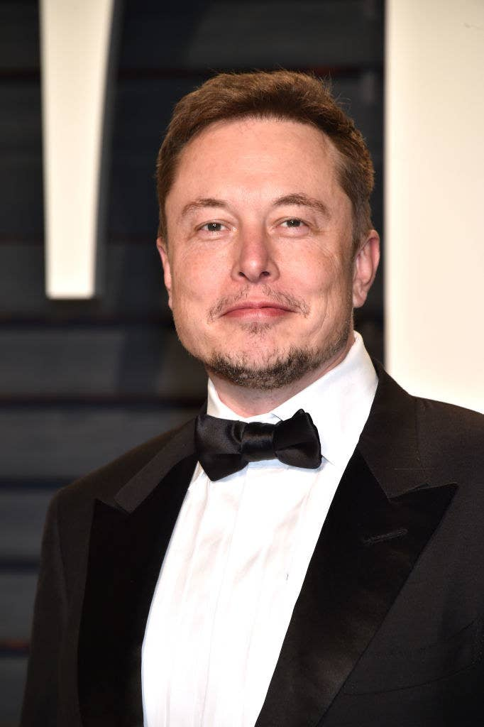 Elon poses for photographers at an event in a tux