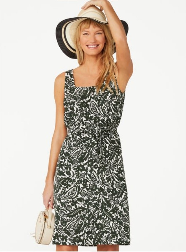 A model wearing a forest green/white floral square neck belted dress