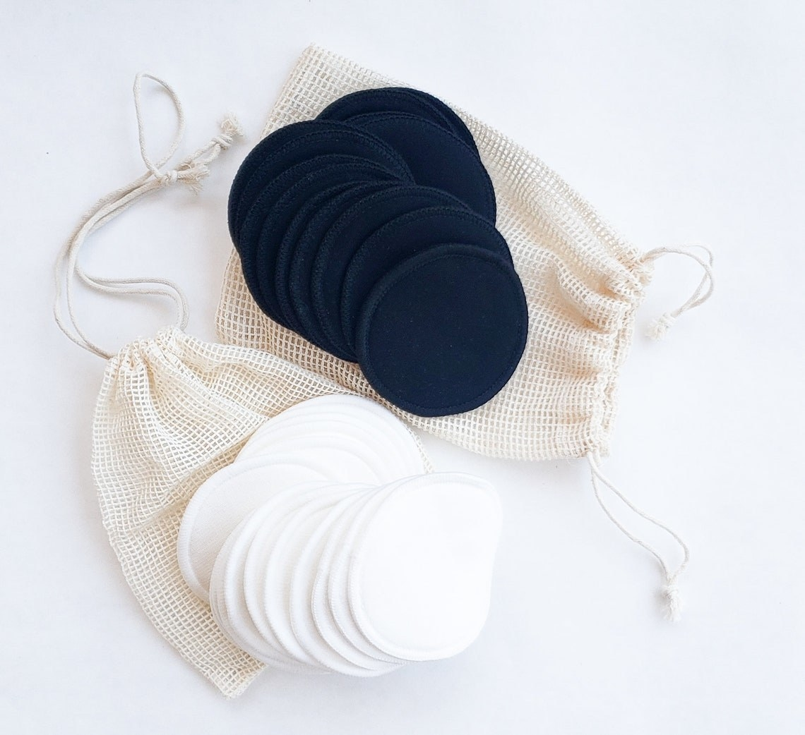 the rounds in white and in black, on top of taupe mesh drawstring bags