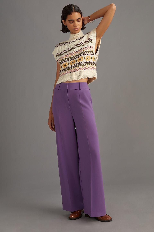 model wearing the purple wide-leg trousers