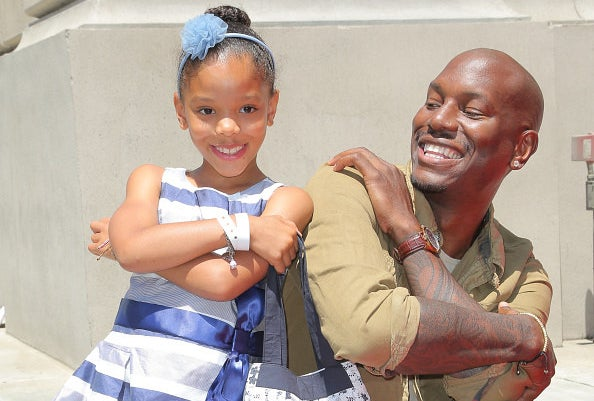 Tyrese posing with his daughter