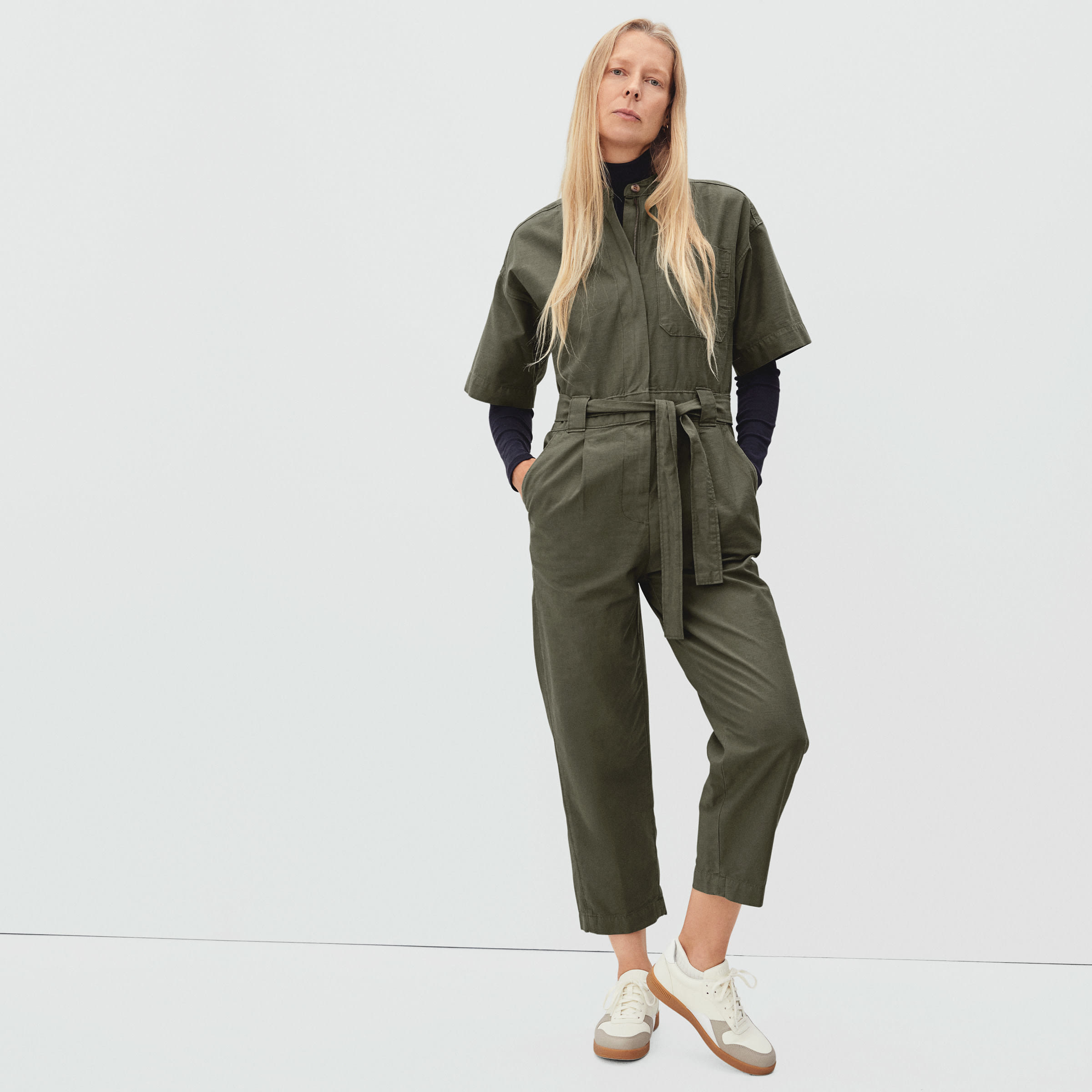 model wearing the green ankle-length short-sleeved jumpsuit
