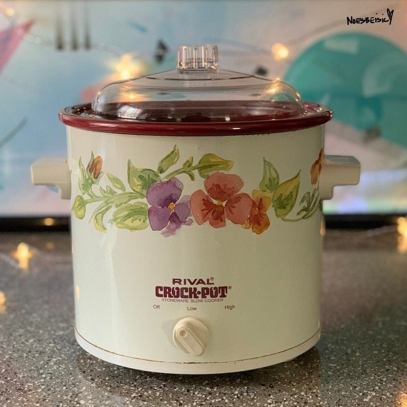A white crock-pot with watercolor flowers on it