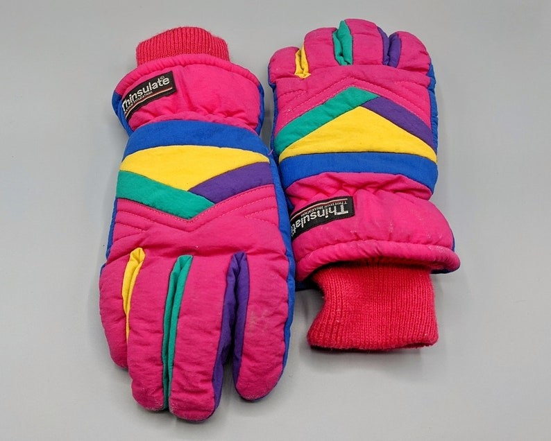 Hot pink, purple, teal, yellow, and royal blue gloves