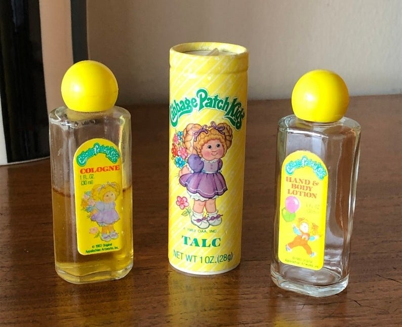 A bottle of Cabbage Patch Kids' cologne, talc, and a hand and body lotion