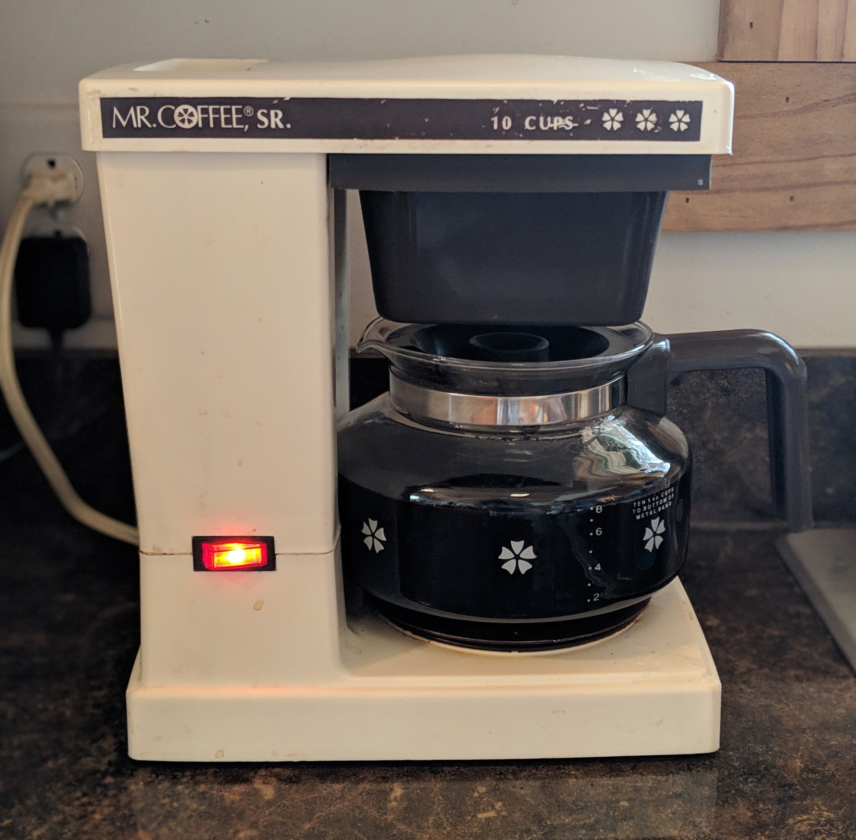 A white Mr Coffee maker with just one button
