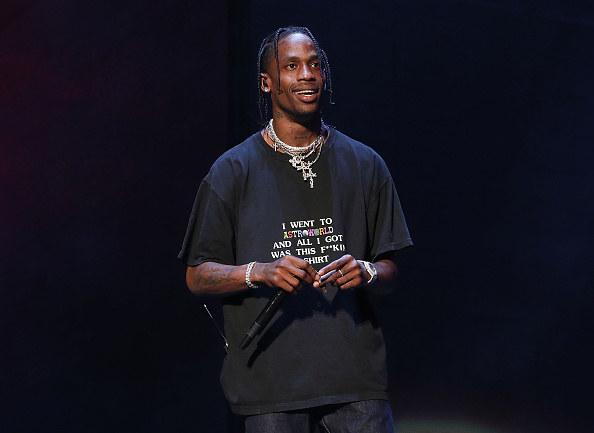 Travis smiling onstage