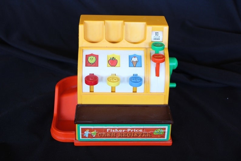 A yellow, brown, and orange toy register