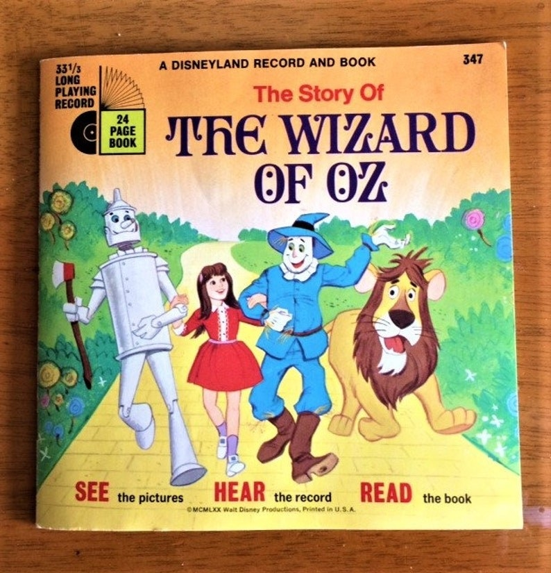 A Disney Book on Record from the '70s, featuring a drawing of the Tin Man, Dorothy, Scarecrow, and Cowardly Lion walking down the Yellow Brick Road