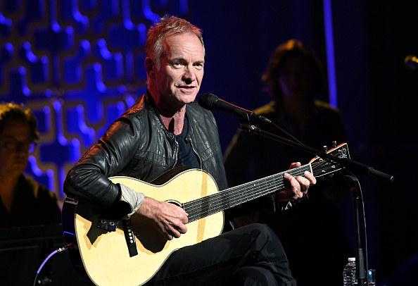 Sting playing guitar