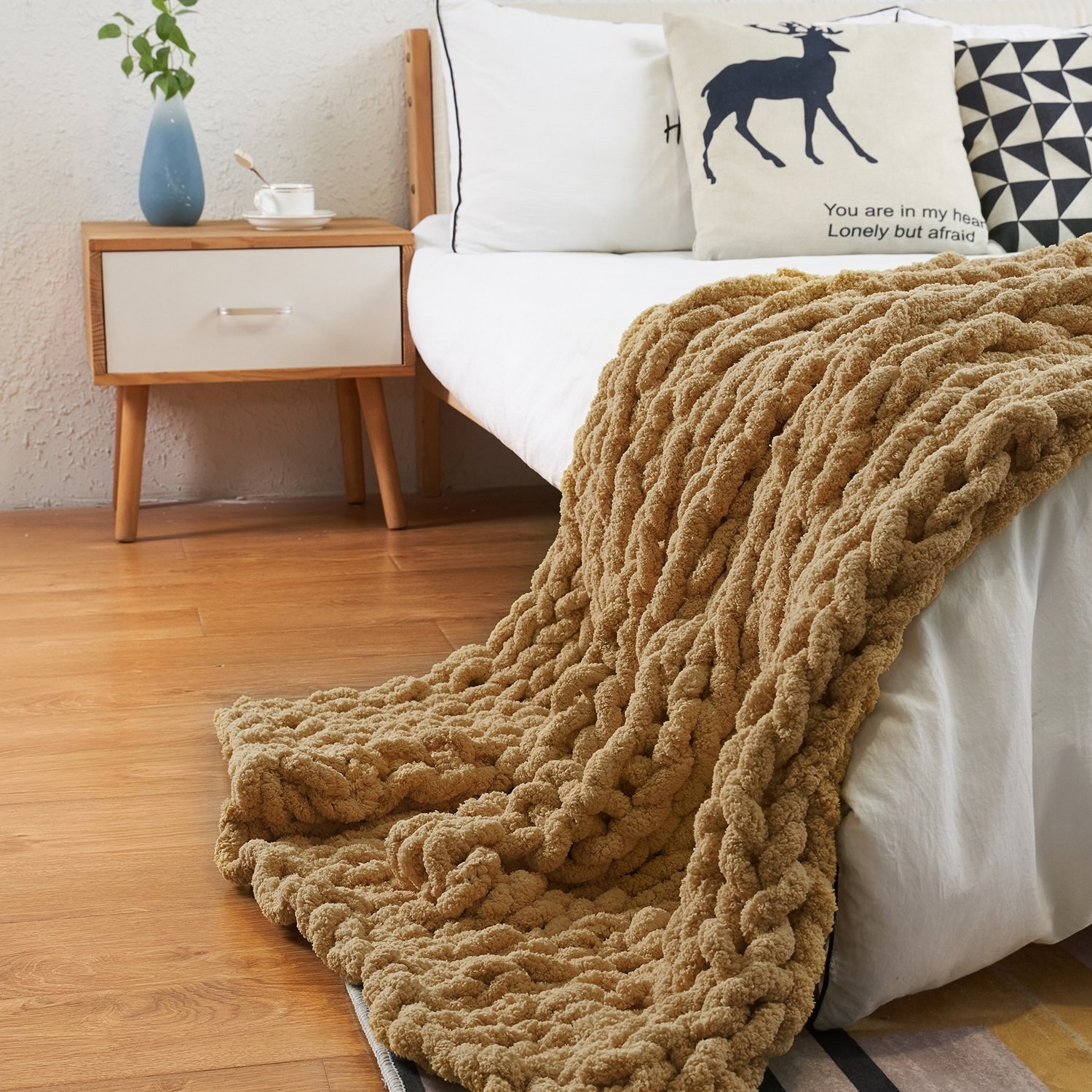 Brown chunky blanket on bed