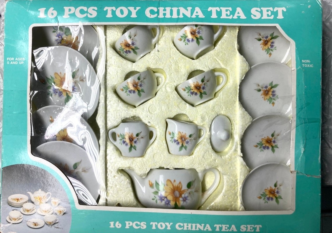A 16-piece toy china set in box