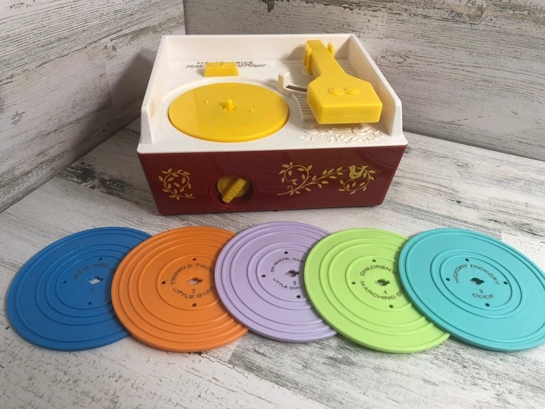 1970s-era toy record player with five different discs
