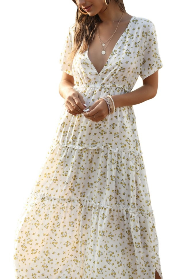A white, v-necked floral maxi dress with small yellow florals