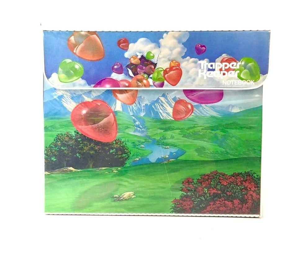 Folder with balloons flying over a mountain side