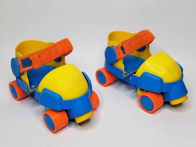 Yellow, blue, and orange pre-school aged skates