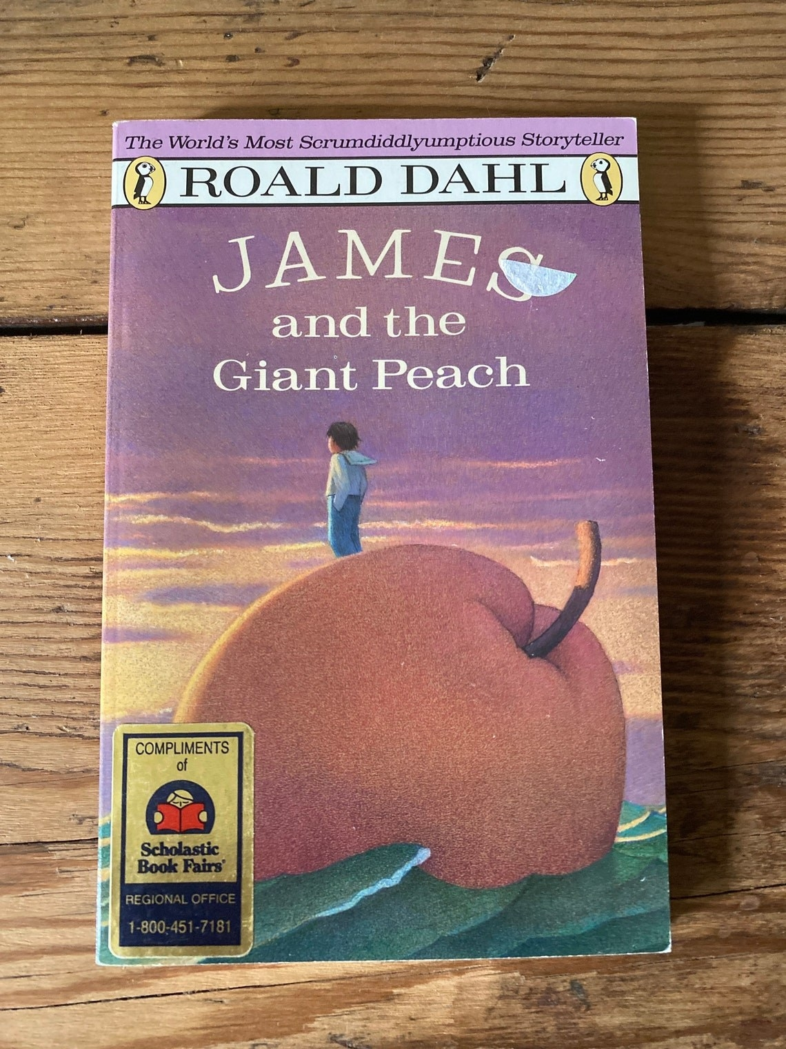 Cover with James standing on a giant peach staring into the sunset