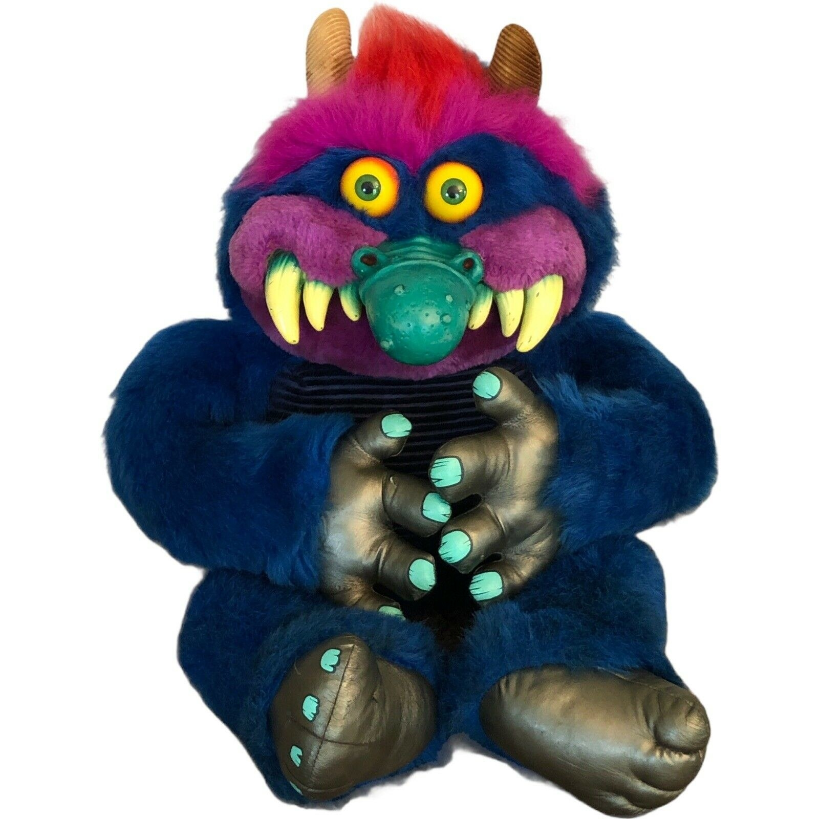 A cute-ish blue and purple monster with a big teal plastic nose