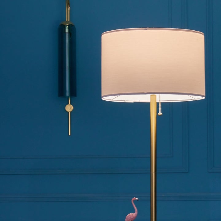 Lamp against blue wall