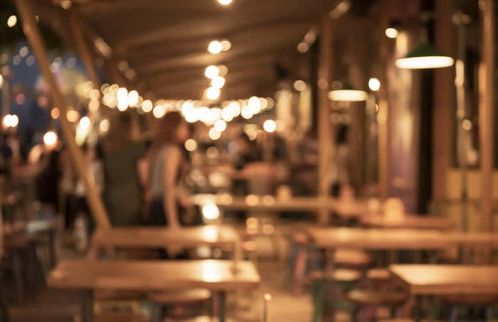 A blurry photo of an outdoor restaurant sitting space