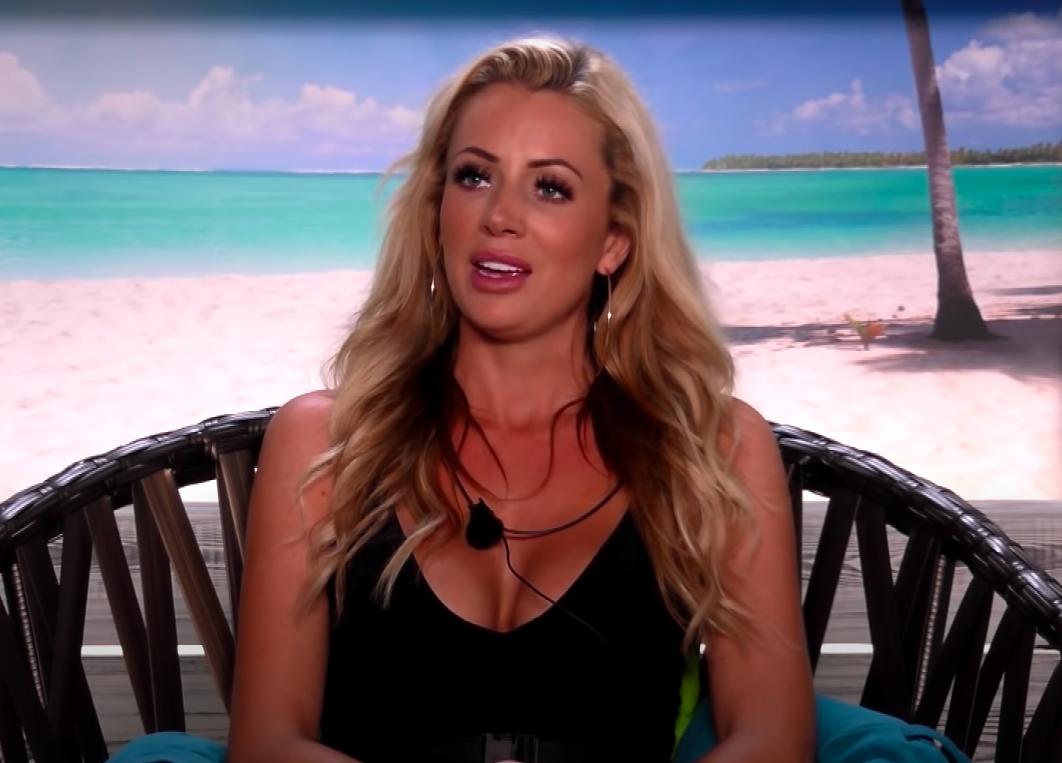Olivia talking in the beach hut