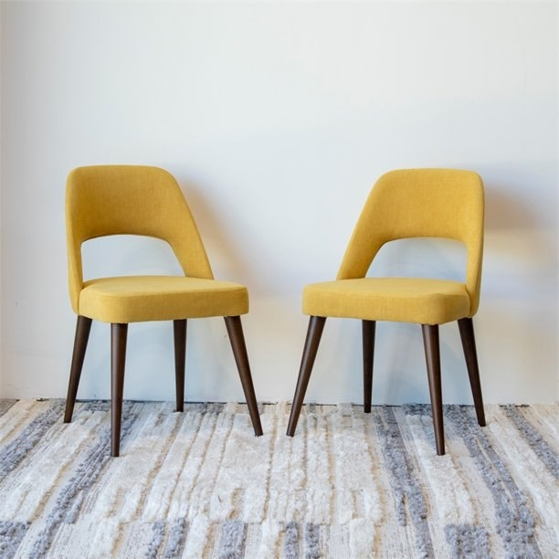 Two yellow modern chairs