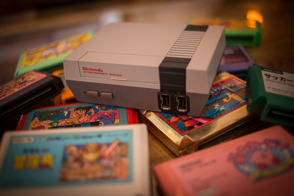 A Nintendo game console surrounded by cartridges