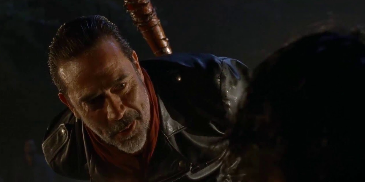 Negan looking down at one of his potential victims