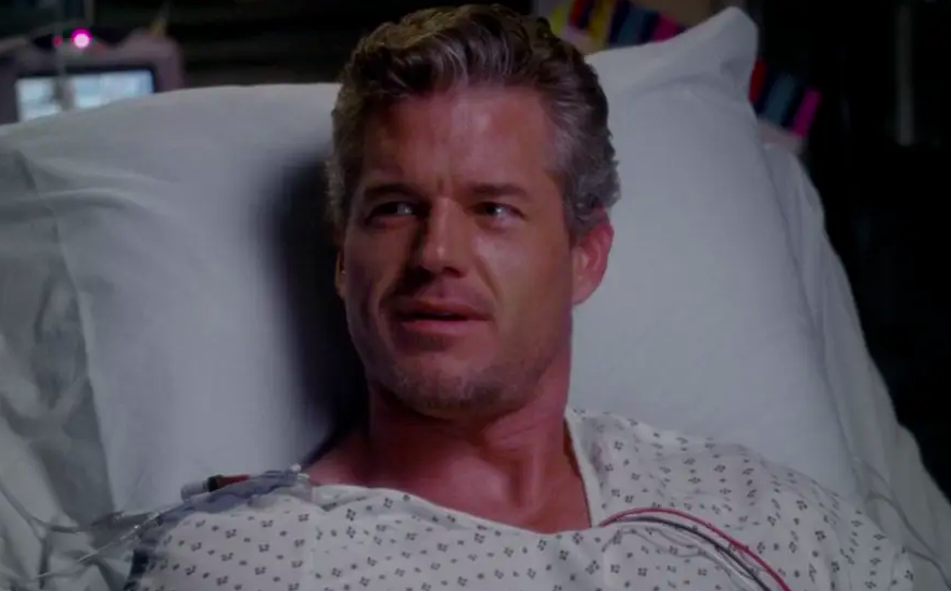 Mark sitting up in his hospital bed