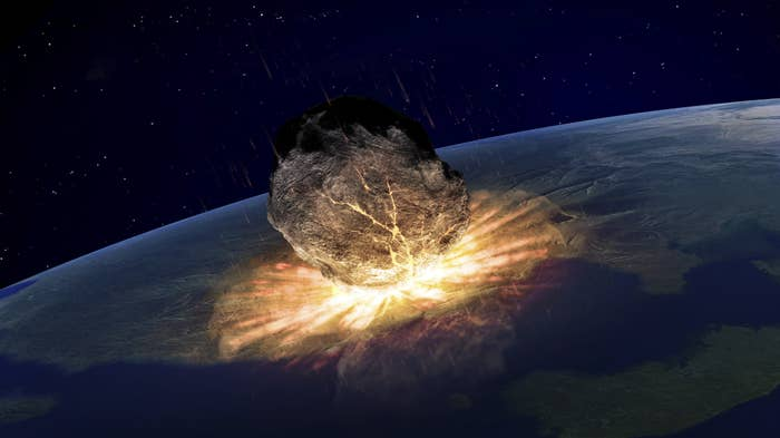 An asteroid hits the surface of the Earth