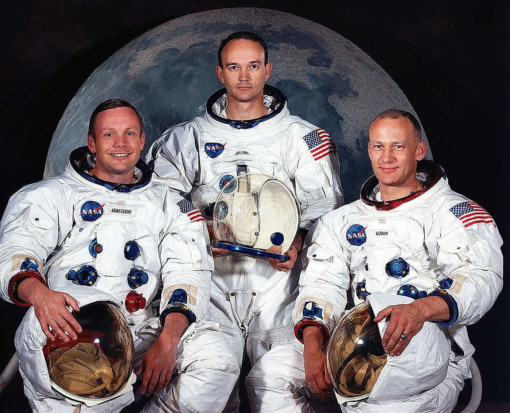 the three astronauts posing in their spacesuits