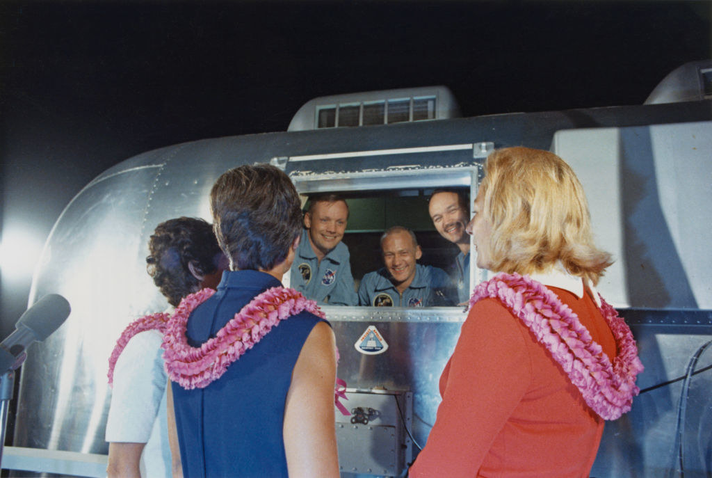 The astronauts talking to their wives from inside the lunar capsule