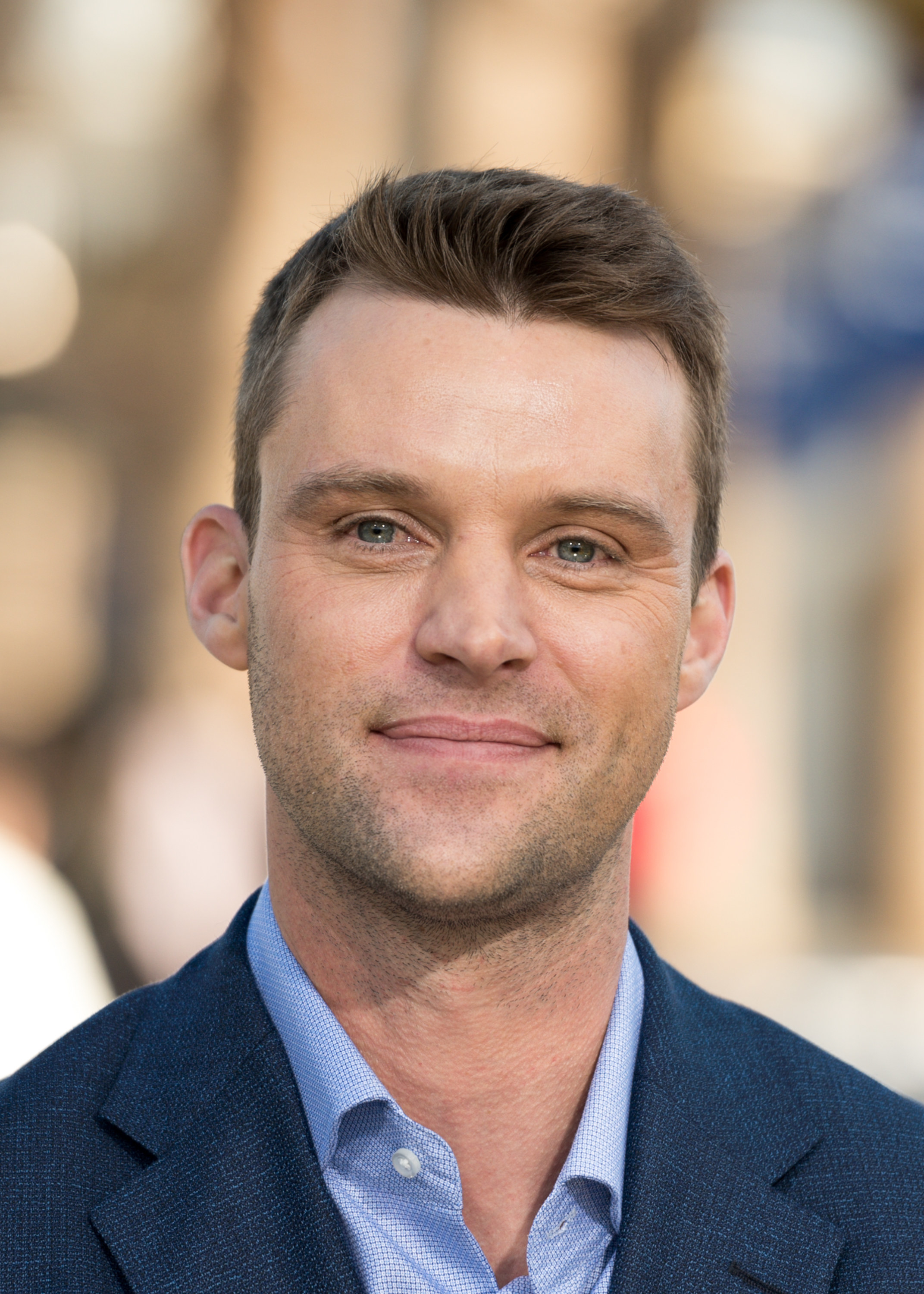 Jesse Spencer poses in a suit